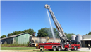 2007 E One 95 Foot Platform Fire Engine with Boom Raised