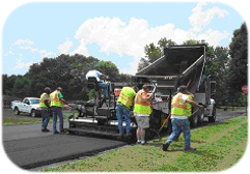 Public Works Workers Paving Road