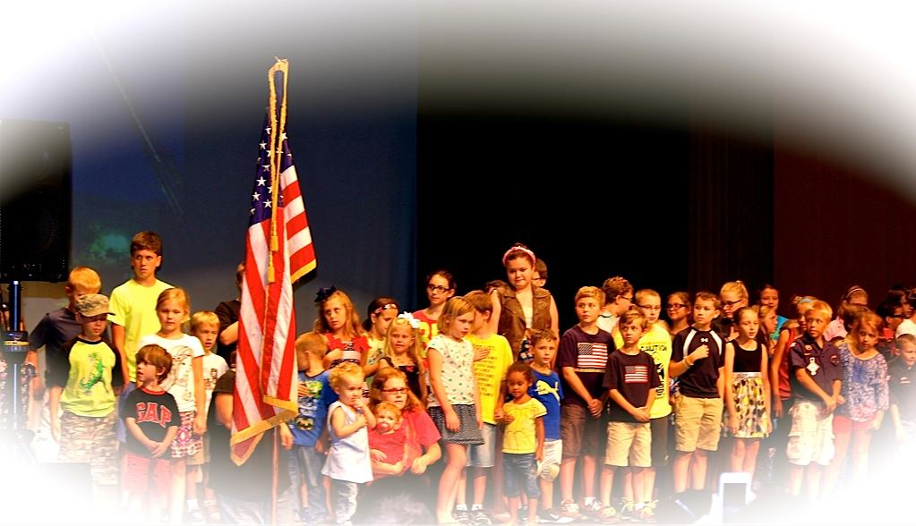 Children Reciting the National Anthem Next to American Flag with Vignette