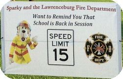 Sparky and the Lawrenceburg Fire Department Want to Remind You That School is Back in Session